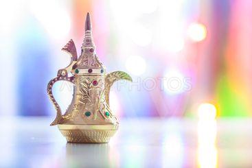 Silver Arabic Coffee pot in colorful illuminated...