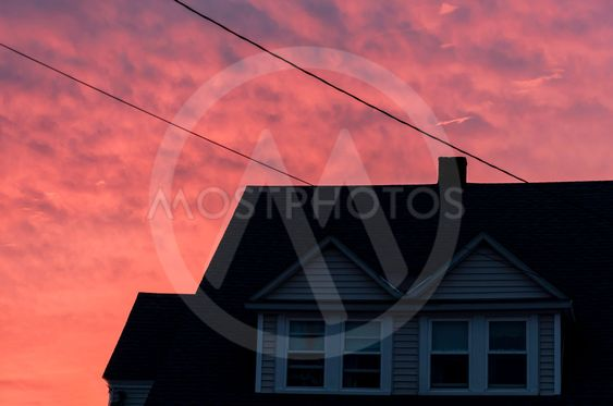 sunset creates an orange tone to the houses