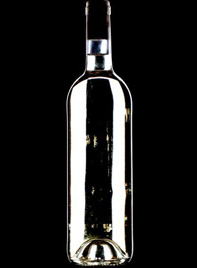 White wine bottle on black