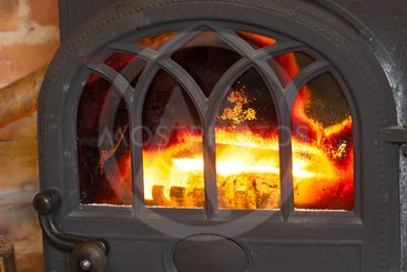 Closeup fireplace with fire interior. Heating.