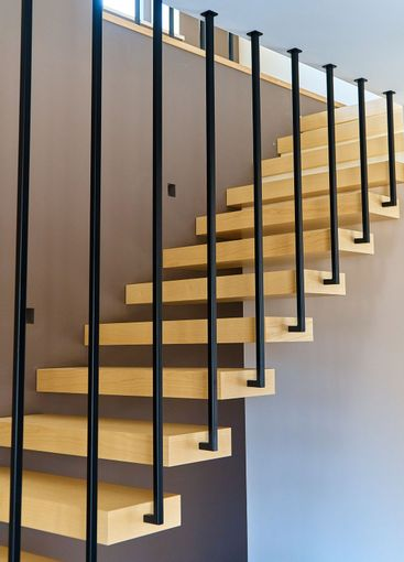 Floating stairs. Ash lumber stairs with metal railing...