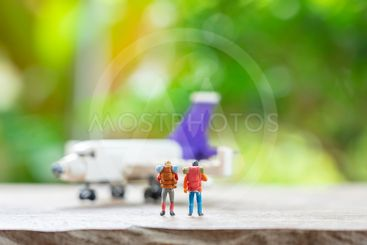 Miniature 2 people standing travel planner with Plane...