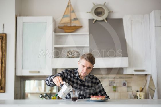 Food, morning and people concept - Handsome man drinking...