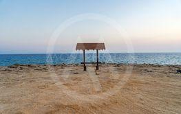 Romantic wooden bench overlooking the beautiful azure...