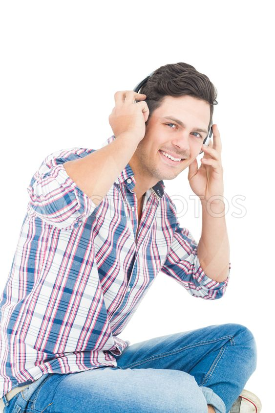 Man with headphones sitting on the floor