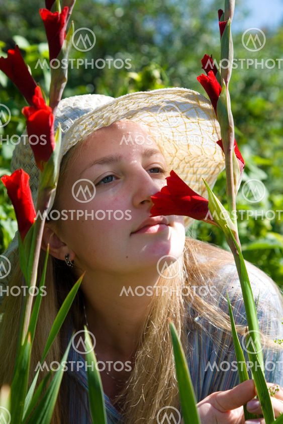 Girl with gladioluses.
