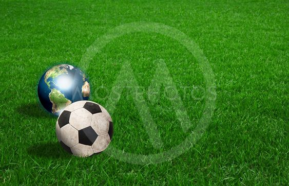 soccer ball and earth on green grass