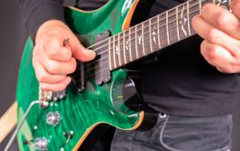 Man's hands playing electric guitar