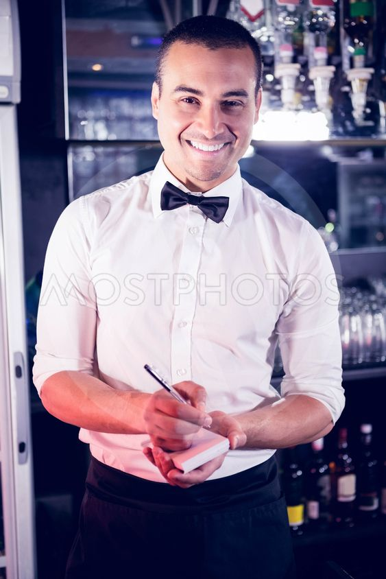 Portrait of a waiter writing down an order