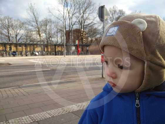 The portrait of the little boy outdoors.