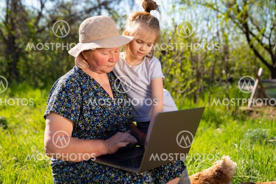 Granddaughter teaches grandma to work on computer