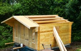 Construction of a wooden guest hut in Sweden