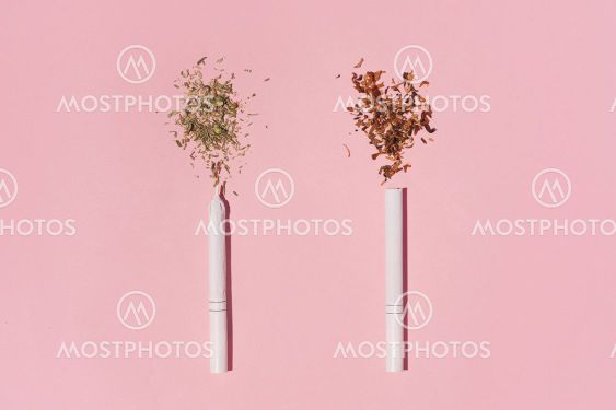 Hipster photo of two Cigarettes, one with tobacco,...