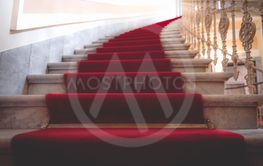 Marble stairways covered with red carpet