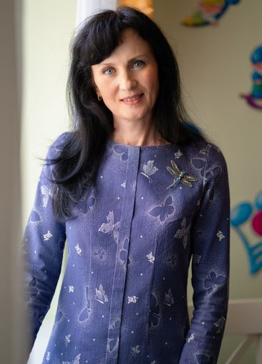 business portrait of an adult woman with dark hair