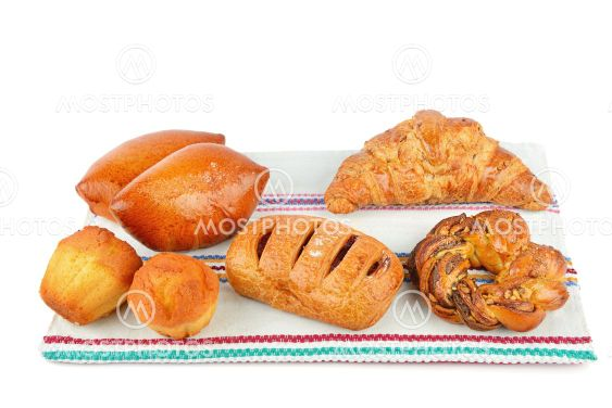Croissant, muffin and other sweet pastries on rustic...