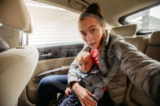 Mother and her baby in car