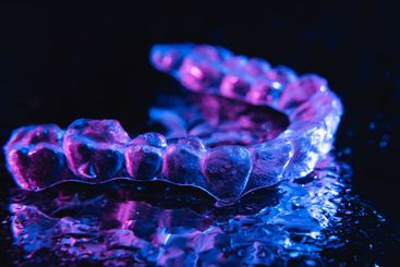 Transparent aligners, tooth retainers lie on a mirror...