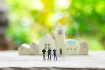 Miniature 3 people businessmen standing with back...