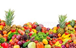 Big pile fruits and vegetables isolated on white