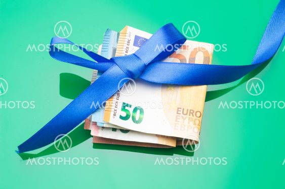 Money decorated with pretty colored bows