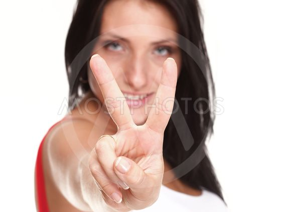 brunette girl smile shows you peace sign isolated