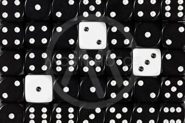 Background of random ordered black dices with three white...