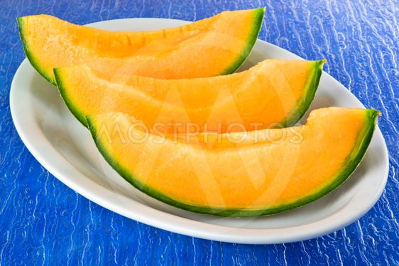 Melon sliced on the blue background