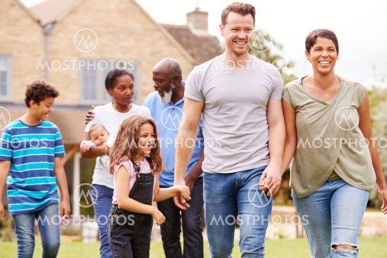 Smiling Multi-Generation Mixed Race Family In Garden At...