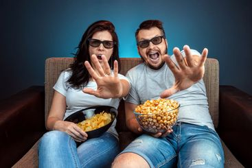 A man and a woman, a family watching a movie or a series...