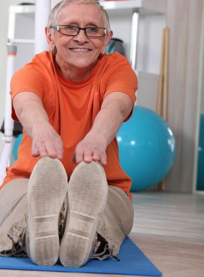 senior woman doing floor exercises